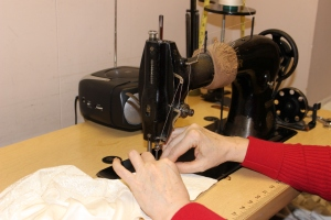 Lady Grace's expert seamstress at work.